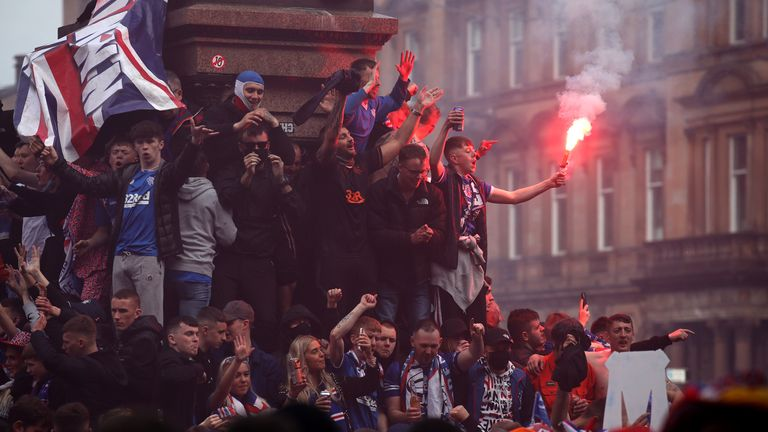 Rangers fans celebrate winning the Scottish Premiership in George Square, Glasgow, after their match against Aberdeen. Picture date: Saturday May 15, 2021.
