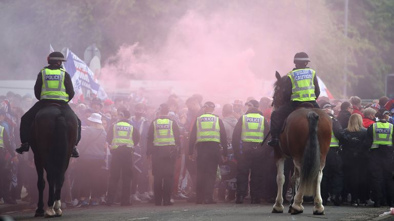 Police and Rangers fans outside the ground before the Scottish Premiership match at Ibrox Stadium, Glasgow. Picture date: Saturday May 15, 2021.