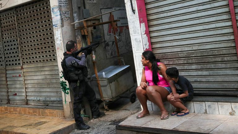 A policeman stands in position during an operation against drug dealers in Jacarezinho slum in Rio de Janeiro, Brazil May 6, 2021. REUTERS/Ricardo Moraes