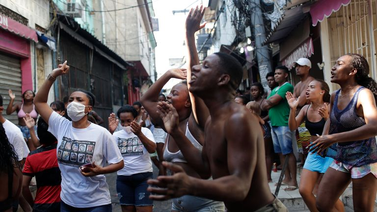 Residents protest a police operation targeting drug traffickers in the Jacarezinho favela of Rio de Janeiro, Brazil, Thursday, May 6, 2021. At least 25 people died during the operation, including one police officer and 24 suspects, according to the press office of Rio's civil police. (AP Photo/Silvia Izquierdo)