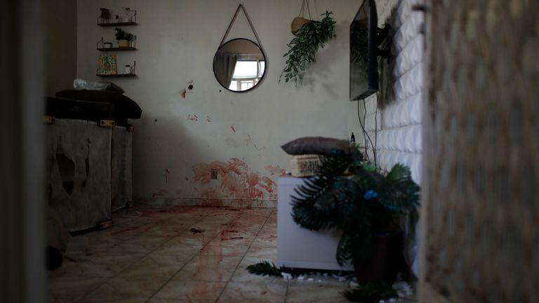 Blood covers the floor inside a home after a police operation targeting drug traffickers in the Jacarezinho favela of Rio de Janeiro, Brazil, Thursday, May 6, 2021. At least 25 people died including one police officer and 24 suspects, according to the press office of Rio...s civil police. (AP Photo/Silvia Izquierdo)