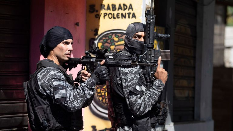 Police conduct an operation against alleged drug traffickers in the Jacarezinho favela of Rio de Janeiro, Brazil, Thursday, May 6, 2021. (AP Photo/Silvia Izquierdo)