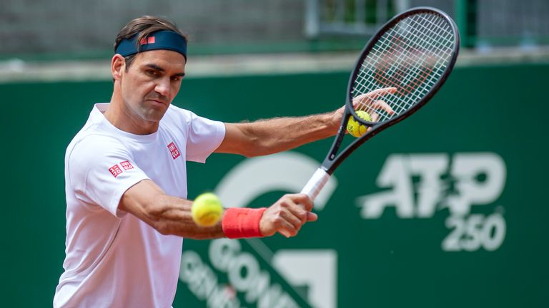Switzerland's tennis player Roger Federer in action during a training session prior to the ATP 250 Tennis Geneva Open tournament, in Geneva, Switzerland, Friday, May 14, 2021. (Martial Trezzini/Keystone via AP)
