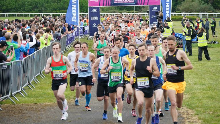 Runners take part in the Reunion 5k run at Kempton Park, London. Picture date: Saturday May 15, 2021.