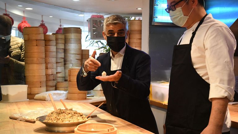Mayor of London Sadiq Khan learning how to make the signature dish at Dumplings' Legend in China Town, as indoor hospitality and entertainment venues reopen to the public