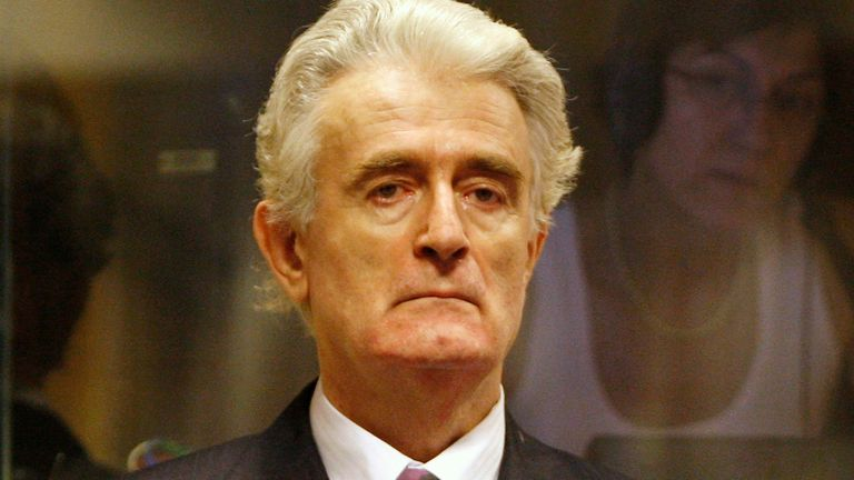 Former Bosnian Serb leader Radovan Karadzic stands in the courtroom during his initial appearance at the U.N.'s Yugoslav war crimes tribunal in The Hague, Netherlands, Thursday July 31, 2008. Karadzic appeared at the U.N.'s Yugoslav war crimes tribunal for the first time Thursday to face charges of genocide and crimes against humanity. Prosecutors allege Karadzic masterminded atrocities, including the Srebrenica massacre and siege of Sarajevo during Bosnia's 1992-95 war. (AP Photo/ Jerry Lampen,