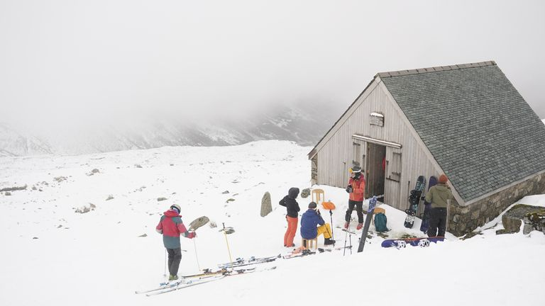 Skiers rest during heavy snowfall at the Lake District Ski Club on Raise, next to Helvellyn in the Lake District National Park, after an unseasonal May snowfall allowed the reopening of the slopes. Picture date: Thursday May 6, 2021.