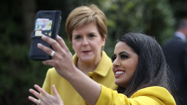 Nicola Sturgeon takes a picture with Anum Qaisar-Javed, the SNP candidate for the Airdrie and Shotts by-election