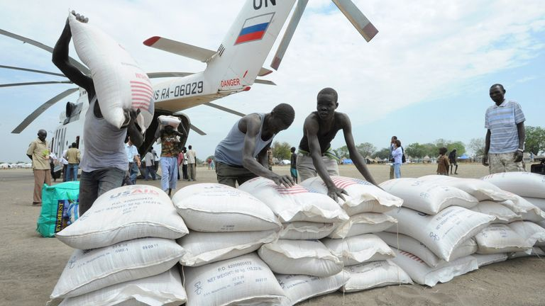Boxes and bags of food from the World Food Program (WFP) are unloaded from a United Nations helicopter in Pibor in 2012