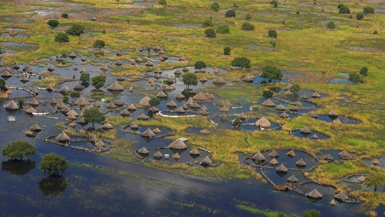 An aerial view shows flooded homes within a village after the River Nile broke the dykes in Jonglei State, South Sudan last year