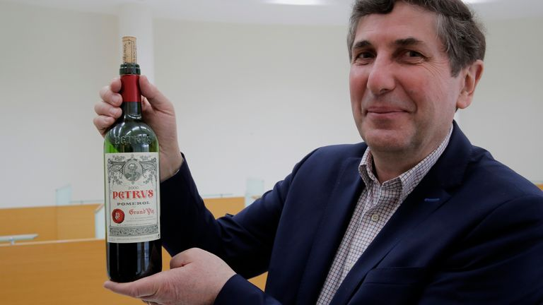 Philippe Darriet, President, ISVV Institute for wine and vine research and Head oenologist holds a bottle of Petrus red wine that spent a year orbiting the world in the International Space Station after a tasting at the ISVV Institute in Villenave-d'Ornon, southwestern France, Monday, March 1, 2021. Researchers in Bordeaux are analyzing a dozen bottles of the precious liquid – along with 320 snippets of Merlot and Cabernet Sauvignon grapevines – that returned to Earth in January after a sojourn