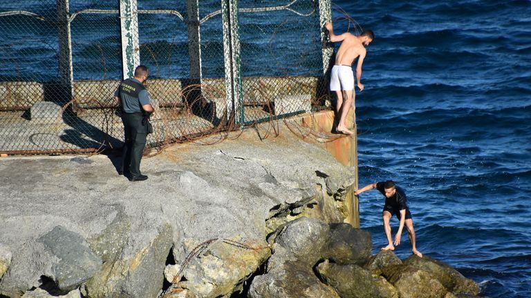 Thousands of migrants swam into Ceuta. Pic: Reduan Ben Zakouor/El Faro de Ceuta via Reuters