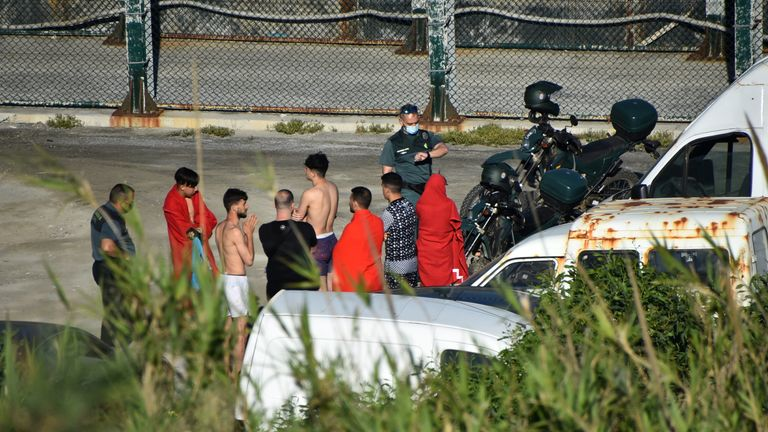 Spanish civil guards met the migrants. Pic: Reduan Ben Zakouor/El Faro de Ceuta via Reuters