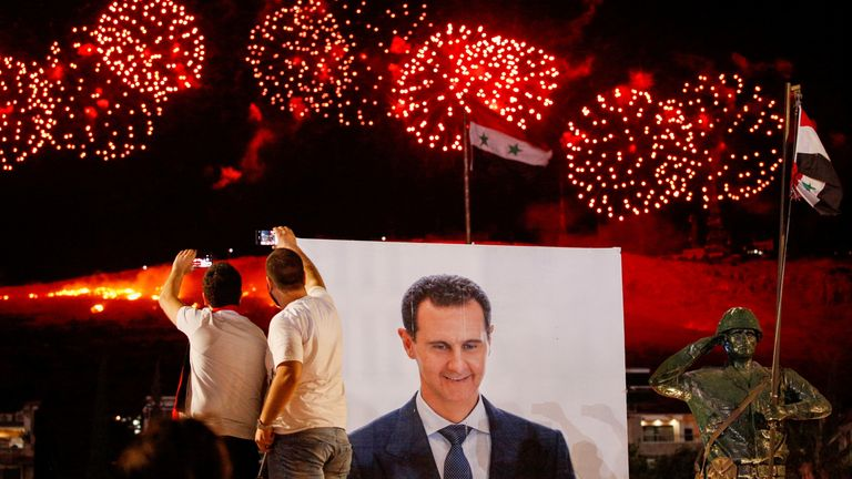 Fireworks lit up the sky as supporters in Syria's capital celebrated the result