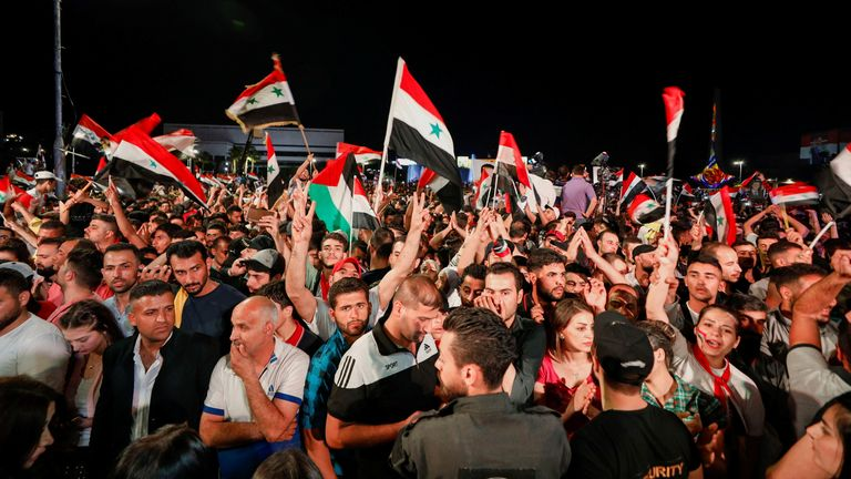 Supporters of the president celebrated in Damascus