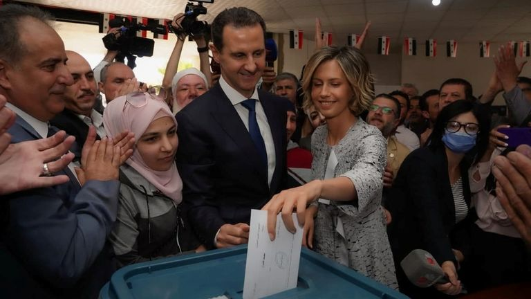 President Bashar al Assad with his wife Asma as she casts her vote