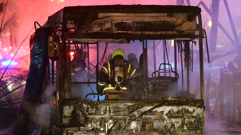 A bus is seen burnt out after the strikes in Holon. Pic: AP
