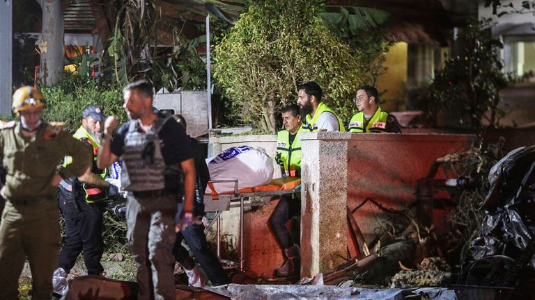 Medics and security forces at the site of another strike in Rishon Lezion. Pic: AP