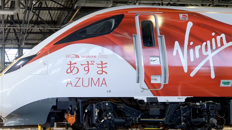 Prime Minister David Cameron (left) and Japanese Prime Minister Shinzo Abe tour the Hitachi North Pole train maintenance Depot in West London