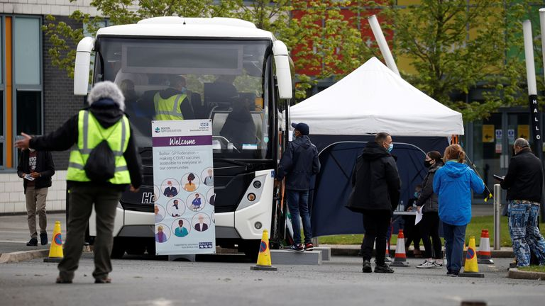 People line up outside a mobile vaccination centre, amid the outbreak of the coronavirus disease (COVID-19), in Bolton, Britain, May 13, 2021. REUTERS/Phil Noble