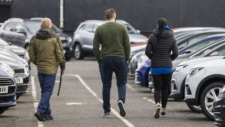 Potential customers walk around Charles Hurst Usedirect used car dealership on Boucher Road in Belfast as restrictions in Northern Ireland ease allowing new and used cars sales. 12/4/2021