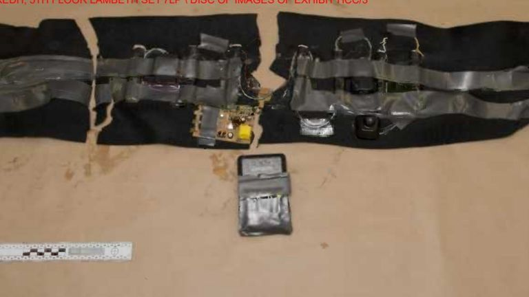 The fake suicide belt worn by Khan