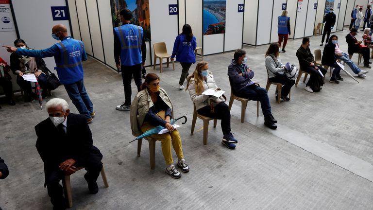 People wait to be given a COVID-19 vaccine in Nice, France