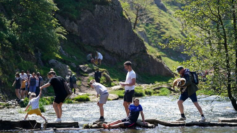 People enjoying the warm weather in Dovedale in the Peak District