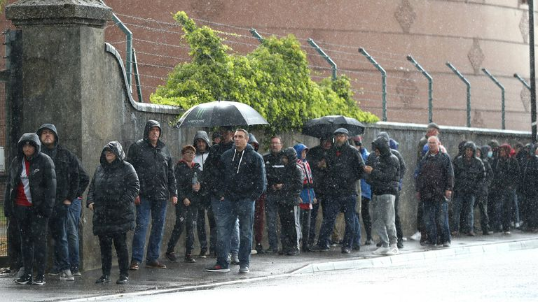 Fans queuing to see a football game for the first time this year had to brave the poor weather