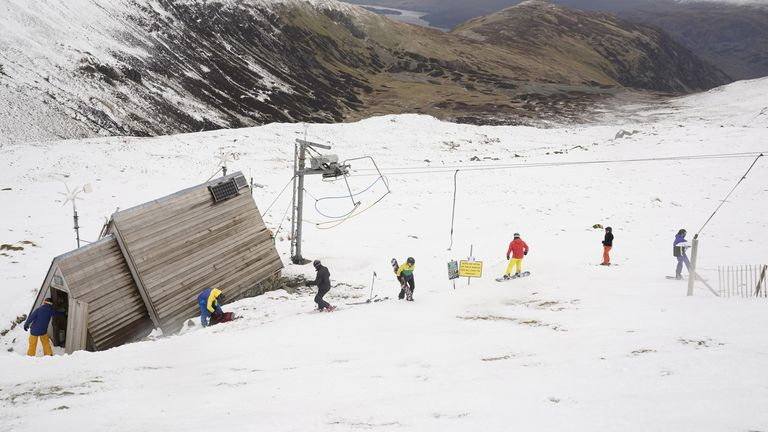 Skiers and snowboarders on the slopes at the Lake District Ski Club on Raise, next to Helvellyn in the Lake District National Park, after an unseasonal May snowfall allowed the reopening of the slopes. Picture date: Thursday May 6, 2021.