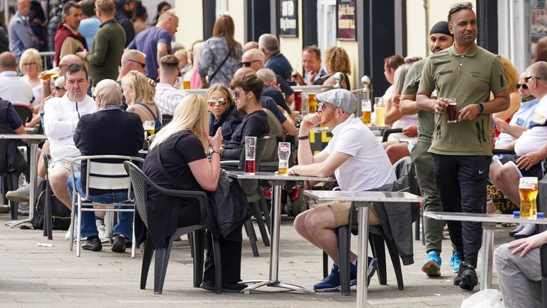People enjoy a drink at a pub along the seafront in Southend