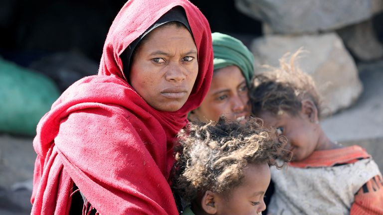 Woman looks as she sits with her children at a camp for internally displaced people on the outskirts of Sanaa A woman looks as she sits with her children at a camp for internally displaced people on the outskirts of Sanaa, Yemen March 1, 2021. REUTERS/Khaled Abdullah