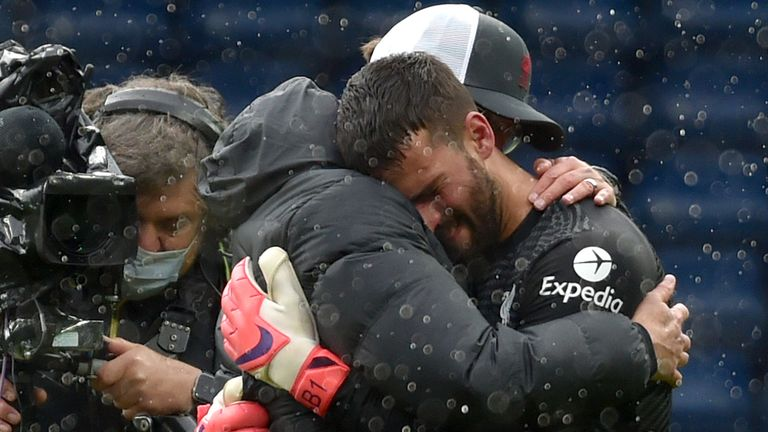 Jurgen Klopp embraces Alisson after his last-gasp winner at West Brom
