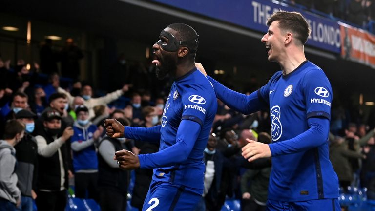 Antonio Rudiger celebrates his goal in front of the fans