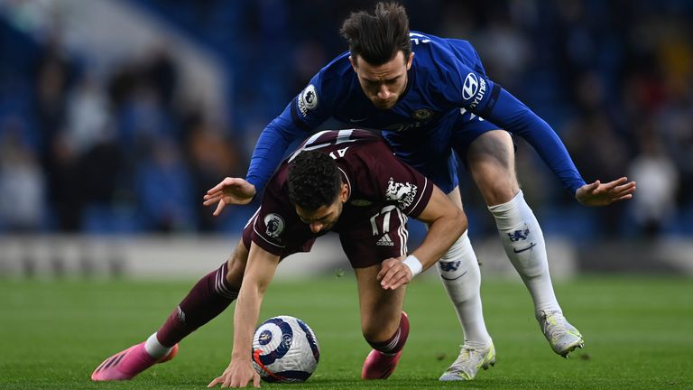 Leicester's Ayoze Perez, front, duels for the ball with Chelsea's Ben Chilwell (AP)