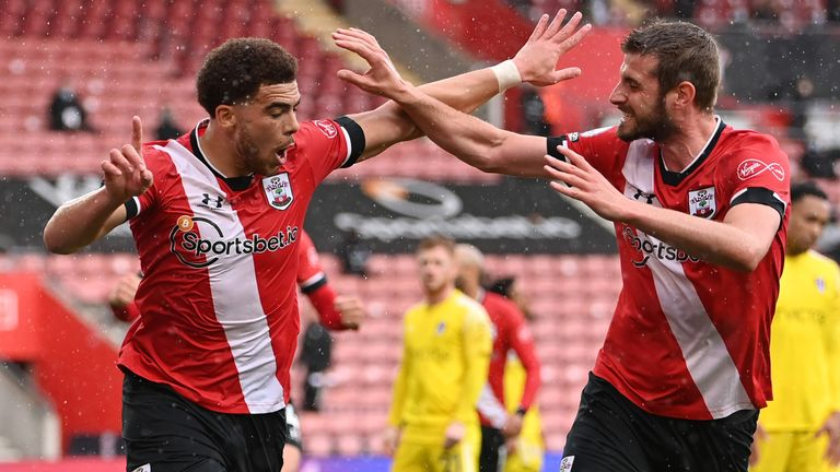 Che Adams celebrates after opening the scoring at St Mary's against Fuilham