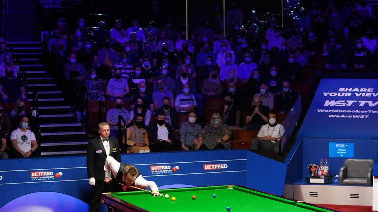 Fans packed into the Crucible in Sheffield to watch the World Snooker Championship on Sunday in what was the first near-capacity crowd at any sports event in the UK for over a year