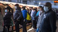 File photo dated 12/5/2020 of passengers wearing face masks on a platform at Canning Town underground station in London. Less crowding is the number one measure that would increase the use of buses and trains, a new survey suggests. Issue date: Wednesday April 14, 2021.