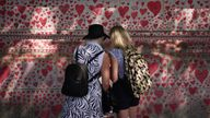 People stood next to the National Covid Memorial Wall on the Embankment in London, following the further easing of lockdown restrictions in England. Picture date: Saturday June 12, 2021.