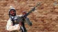 Boko Haram leader Abubakar Shekau holds a weapon in an unknown location in Nigeria in this still image taken from an undated video obtained on January 15, 2018. Pic: Boko Haram Handout/Sahara Reporters