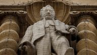 The statue of Cecil Rhodes mounted on the facade of Oriel College in Oxford