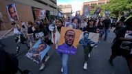 A small group of protesters marches after former Minneapolis police officer Derek Chauvin was sentenced to 22.5 years in prison. Pic: AP