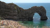 People enjoy the warm weather on the beach at Durdle Door in Dorset, on the first day of meteorological summer. Picture date: Tuesday June 1, 2021.