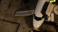 A man was injured when he escaped down a chute shortly after a plane left the gate at Los Angeles airport