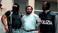 Anti-Mafia police wearing masks to hide their identity, escort top Mafia fugitive Giovani Brusca