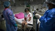 A COVID-19 patient breathes oxygen and monitored by doctors at the Regional Hospital in Iquitos, Peru. Pic: AP