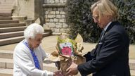 Queen Elizabeth II receives a Duke of Edinburgh rose, given to her by Keith Weed, President of the Royal Horticultural Society