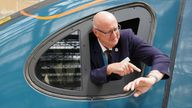 Driver Neil Barker checks his watch on arrival at Glasgow