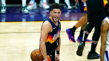 Booker triple-double inspires Suns