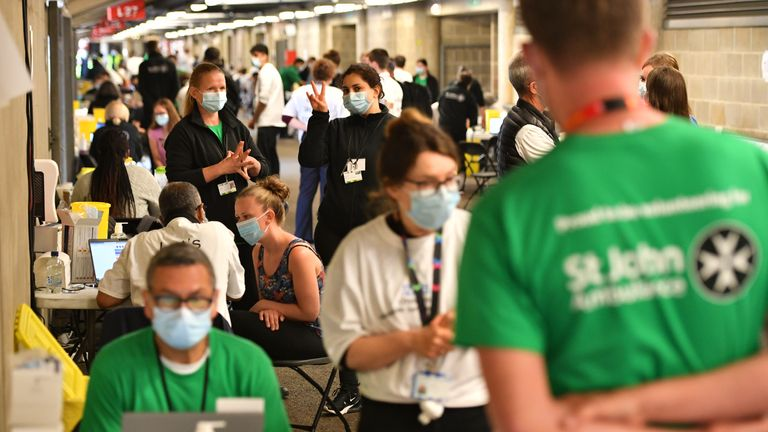 People queue up to receive a coronavirus vaccination at Twickenham rugby stadium, south-west London, where up to 15,000 doses are ready to be administered at the walk-in centre which has been set up for residents of north-west London in response to an increase in the number of cases of coronavirus in the area. Picture date: Monday May 31, 2021.
